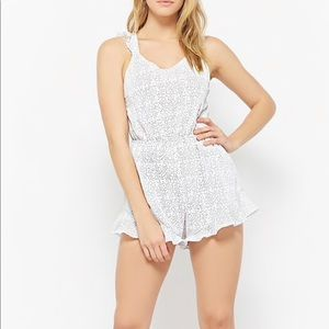 Dotted open back romper